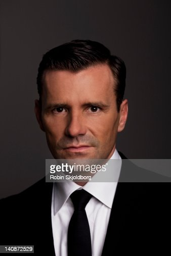 Close up of businessmans frowning face : Stock Photo