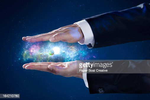 close up of businessman's hand holding a galaxy