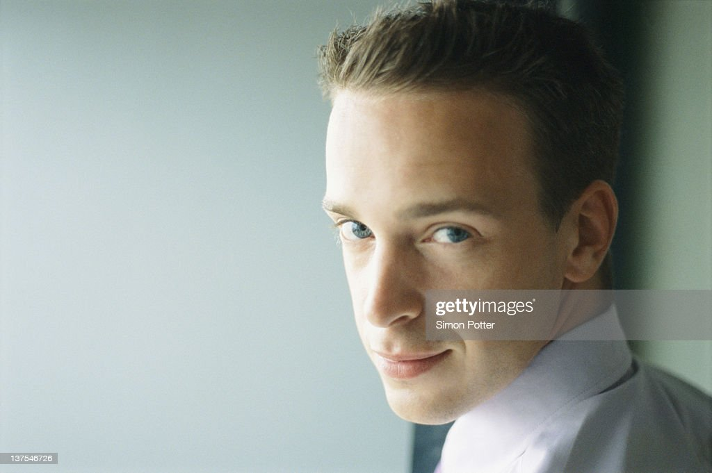 Close up of businessmans smiling face : Stock Photo