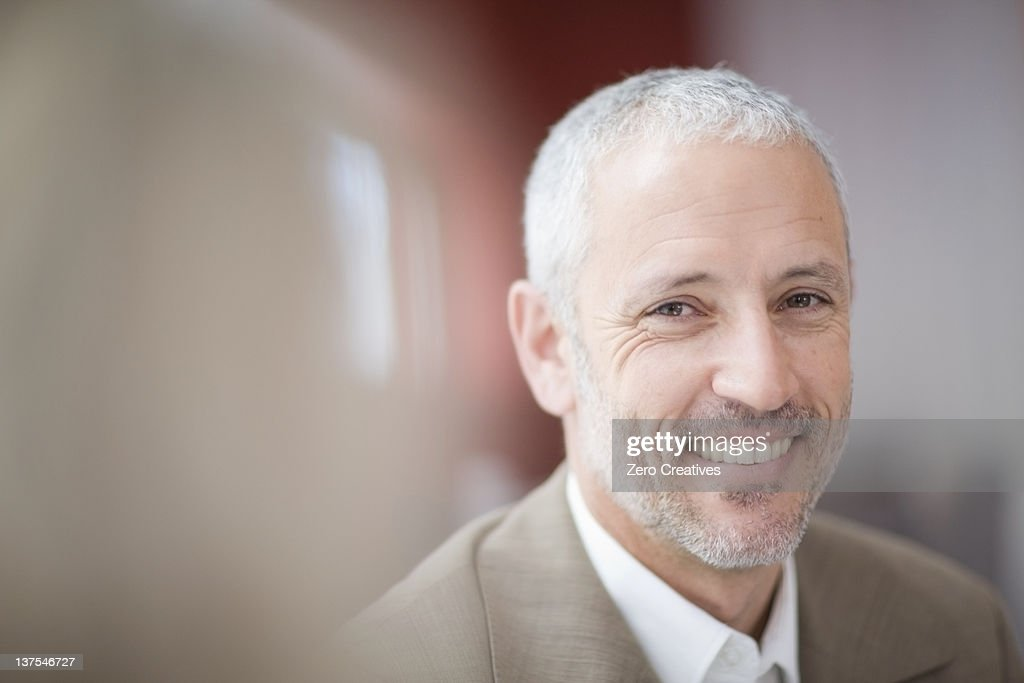 Close up of businessman's smiling face : Stock Photo