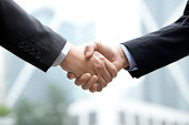 Close up of businessmen shaking hands, Hong Kong