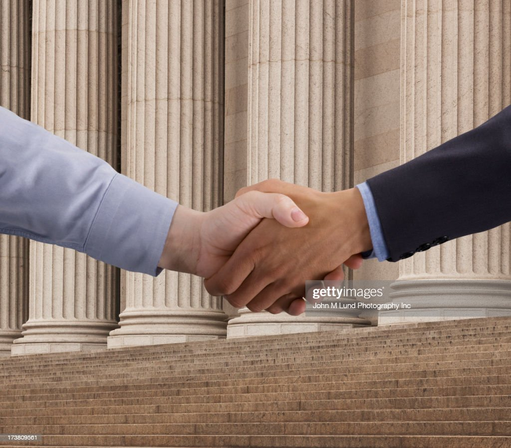 Close up of businessmen shaking hands : Stock Photo