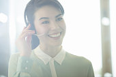 Close up of businesswoman wearing headset