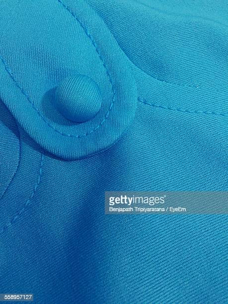 Close Up Of Button On Blouse