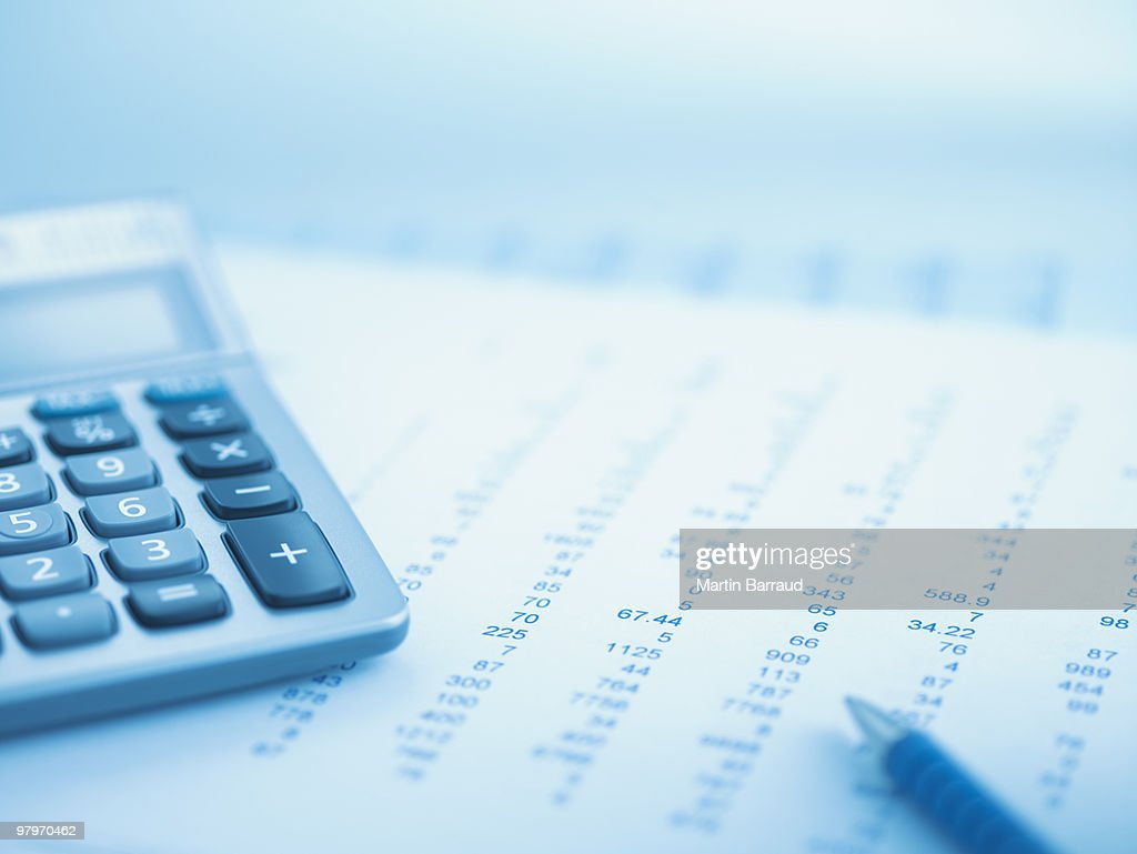 Close up of calculator and data : Stock Photo