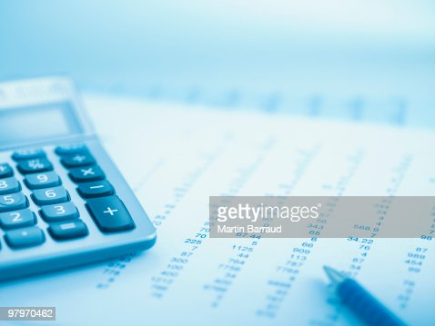 Close up of calculator and data