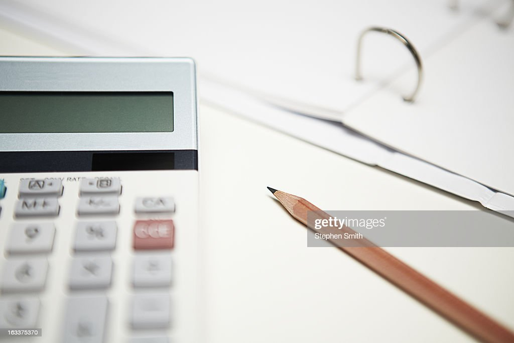 close up of calculator and pencil on desk : Stock Photo