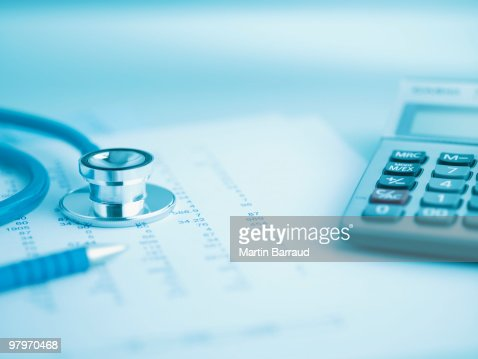 Close up of calculator, data and stethoscope : Stock Photo