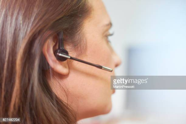 Close up of call center worker's headset