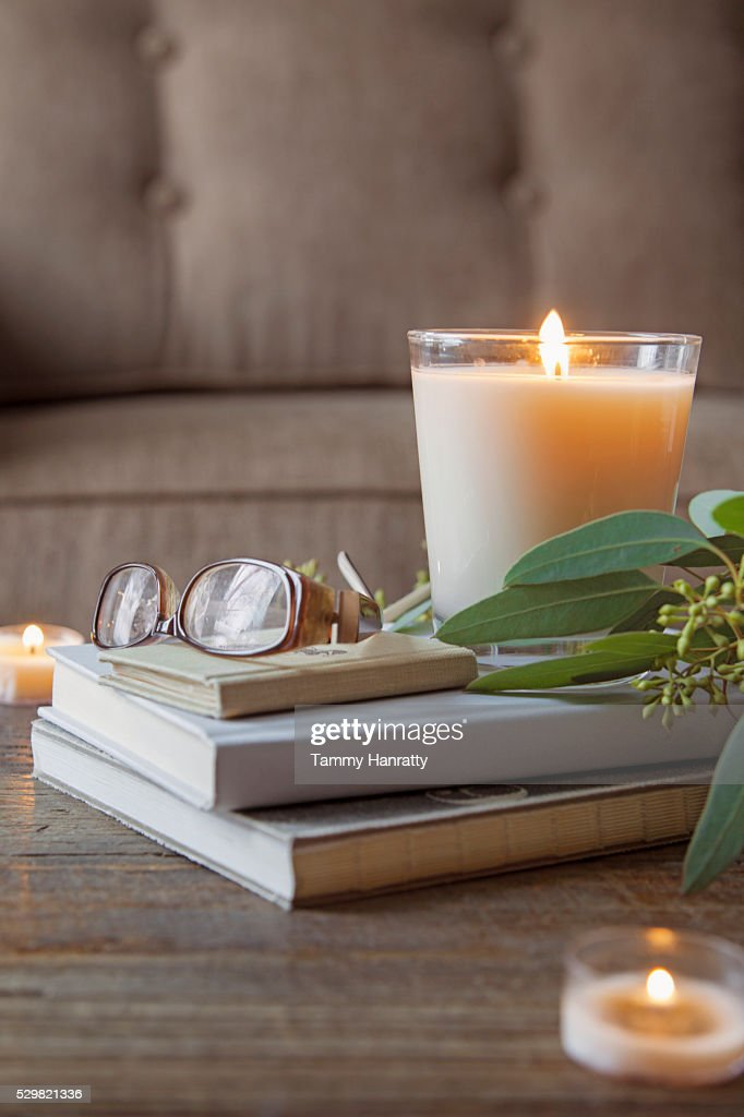 Close up of candle, glasses and books on table : Foto stock