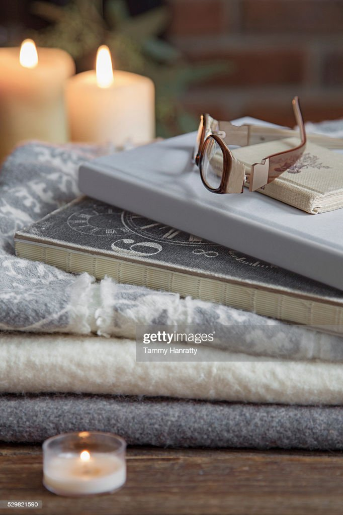 Close up of candle, glasses and books on table : Stock Photo