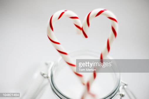 Close up of candy canes forming heart-shape : Stock Photo
