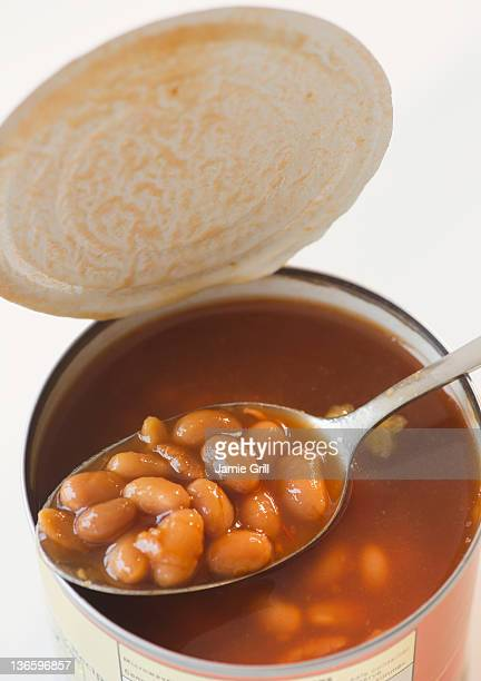Close up of canned baked beans on spoon