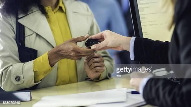Close up of car key exchange