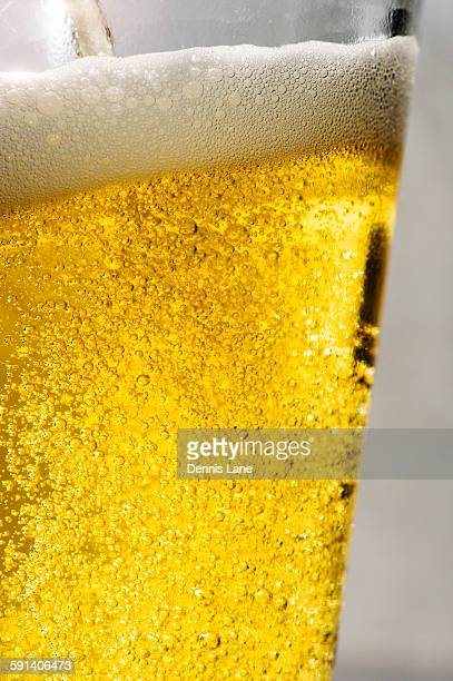 Close up of carbonated beer in glass