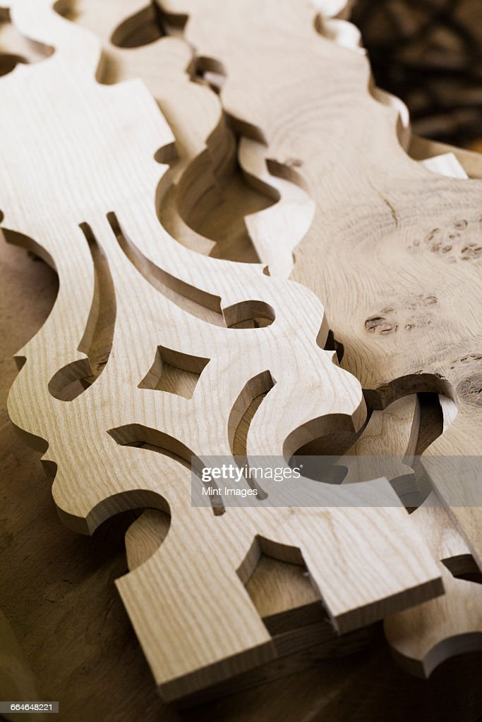 Close up of carved wooden furniture pieces.