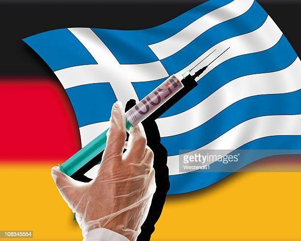 Close up of cash injection on greek flag against german flag