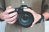 Close up of casual man is holding a camera, Photography Concept.