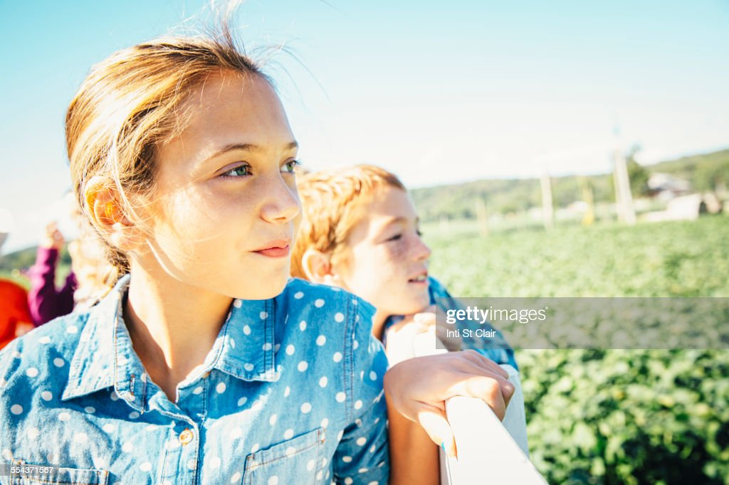 Close up of Caucasian brother and sister admiring farm