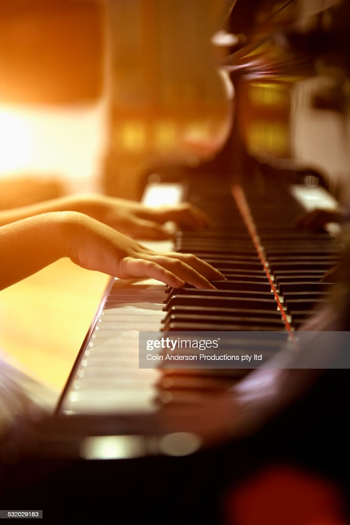 Close up of Caucasian girl playing piano