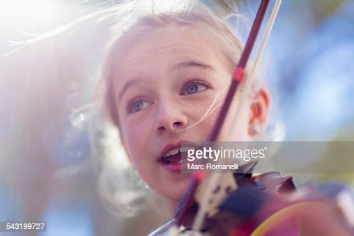 Close up of Caucasian girl playing violin