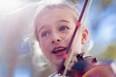 Close up of Caucasian girl playing violin