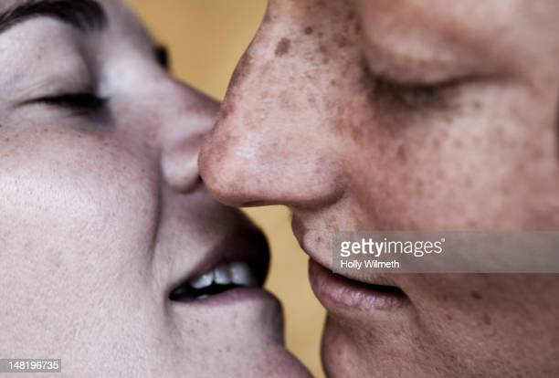 Close up of Caucasian lesbians kissing