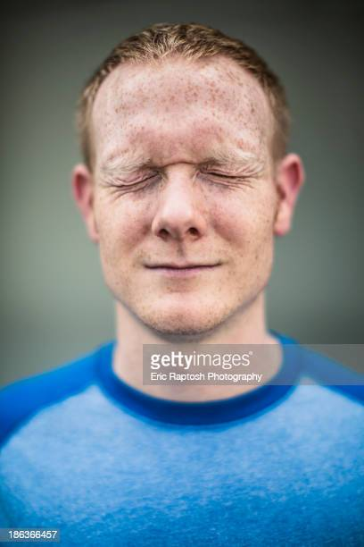Close up of Caucasian man squinting