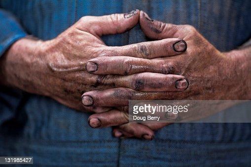 Close up of Caucasian mechanic's dirty hands