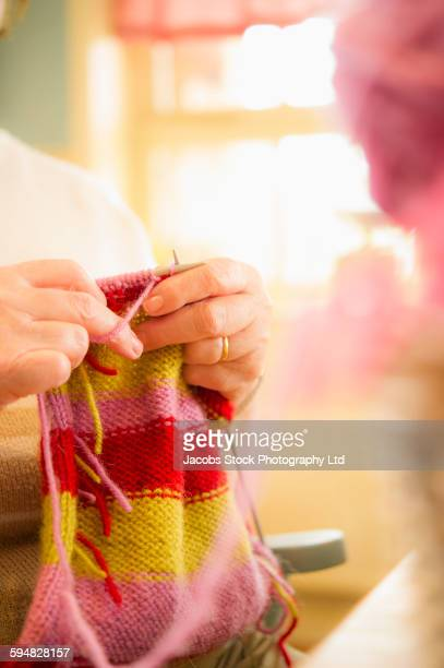 Close up of Caucasian woman knitting