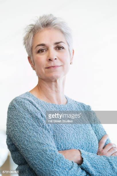Close up of Caucasian woman with arms crossed