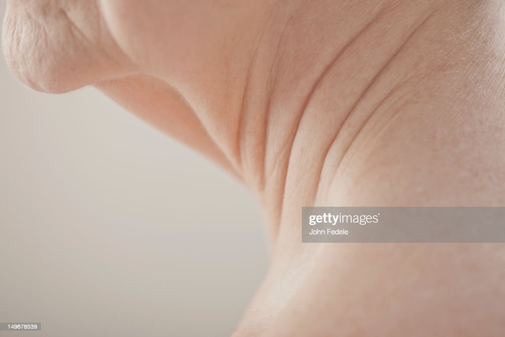 Close up of Caucasian woman's aging neck