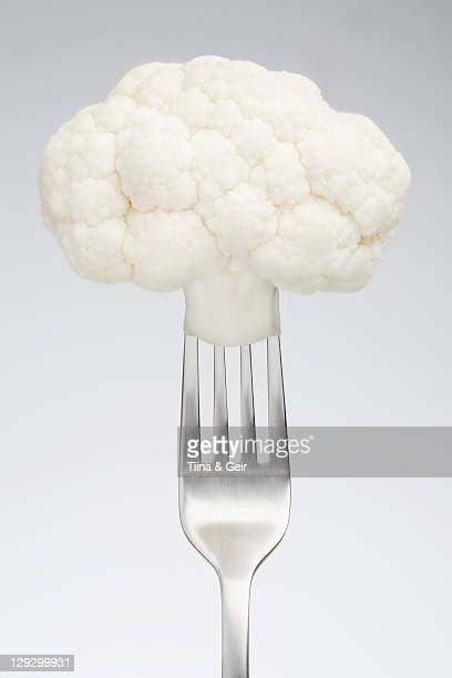 Close up of cauliflower on fork