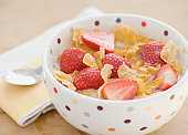 Close up of cereal and strawberries in bowl