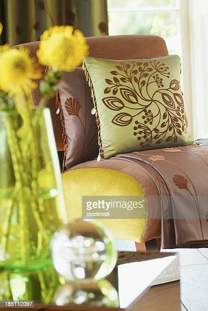 Close up of chair in window with cushions