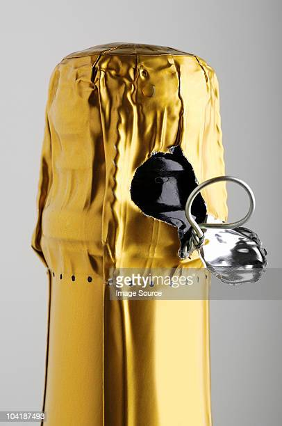 Close up of champagne bottle almost open