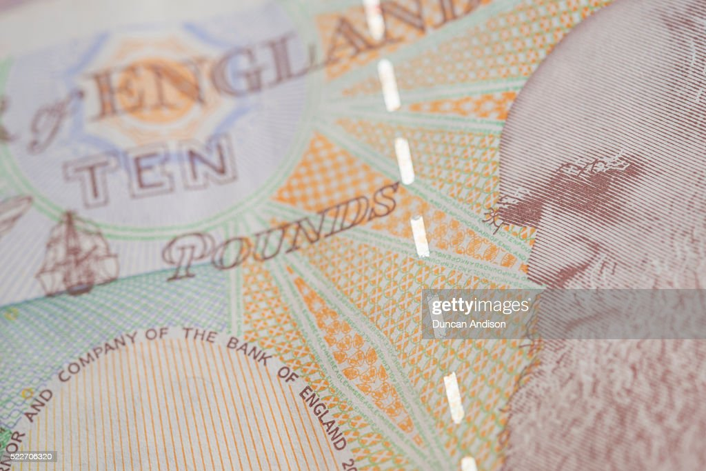 A close up of Charles Darwin on the back of a ten pound note