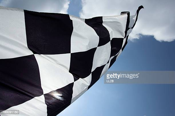 Close up of checkered flag in sky