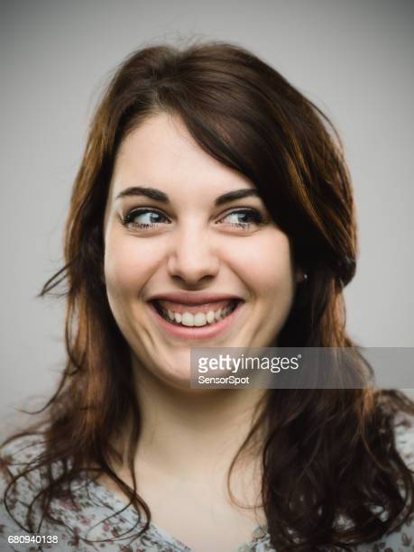 Close up of cheerful woman looking away