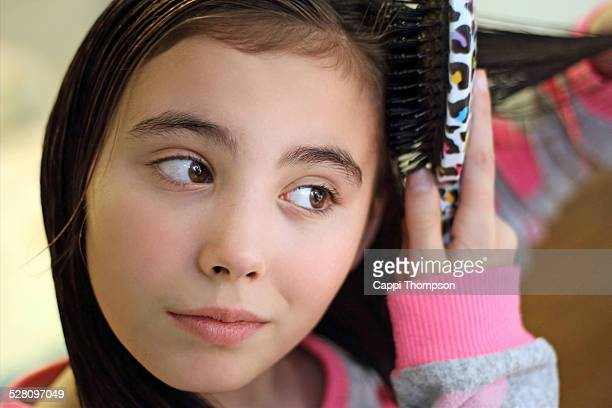 brushing hair stock photos and pictures getty images