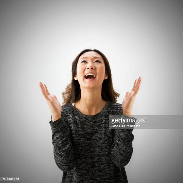 Close up of Chinese woman cheering