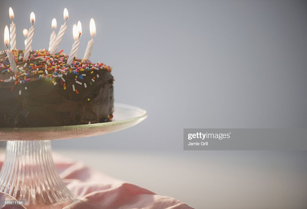 Close up of chocolate birthday cake with candles : Stock Photo