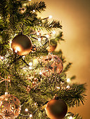 Close up of Christmas ornaments on tree