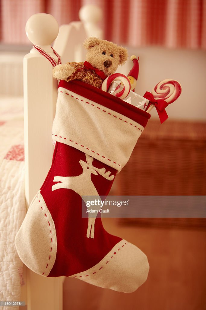 Close up of Christmas stocking hanging from bed : Stock Photo