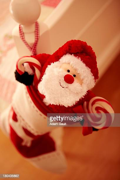 Close up of Christmas stocking hanging from bed