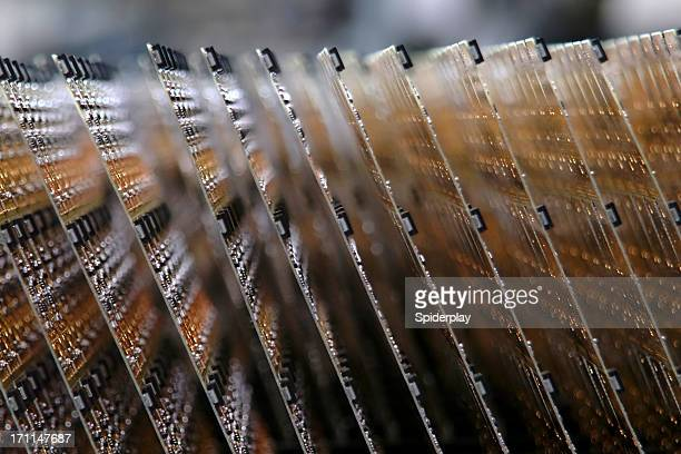 Close up of circuit boards on assembly line