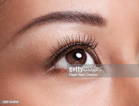 Close up of clear brown eyes looking up at light