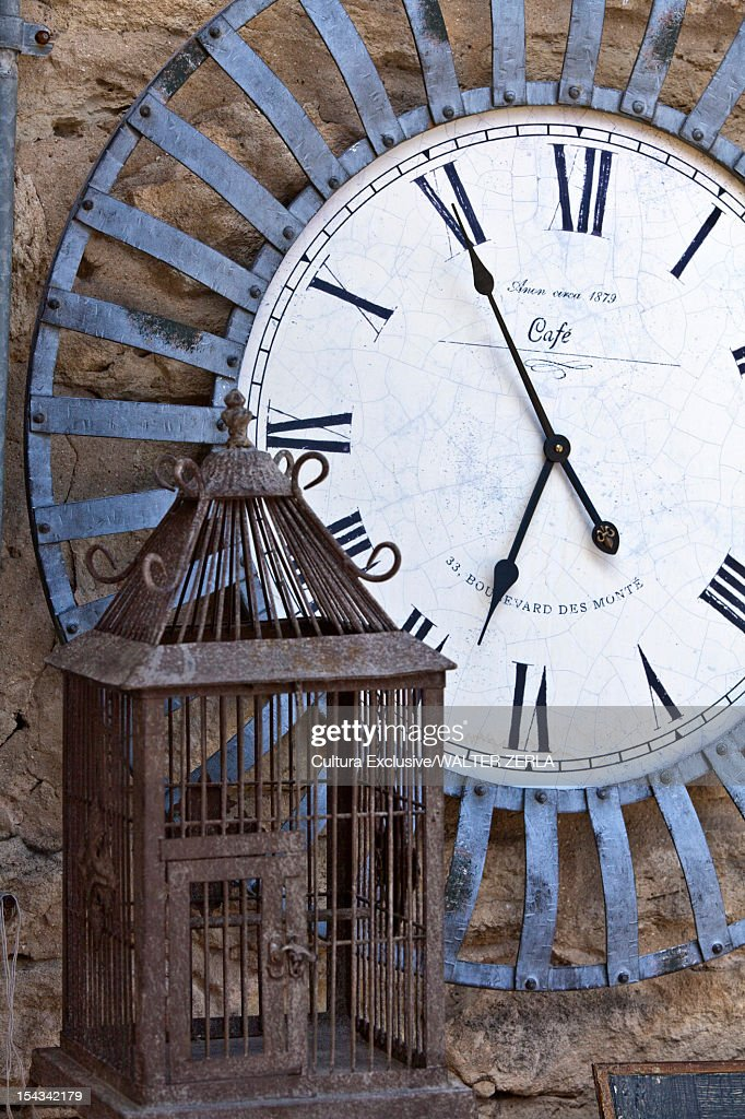 Close up of clock and birdcage : Stock Photo