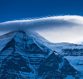 Close up of cloud above snow covered mountain