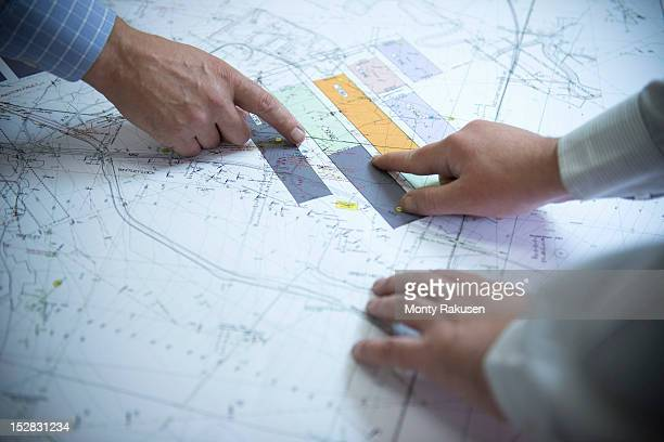 Close up of coal mine plans discussed by engineers